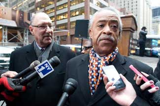 Rev. Al Sharpton addressing demonstrators with Pres. Michael Fishman (left)